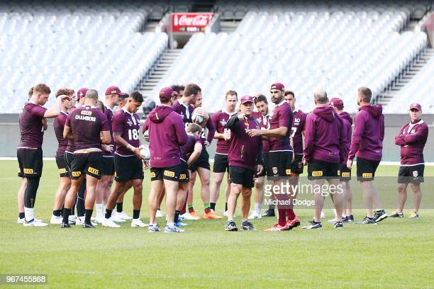 Maroons coach Kevin Walters and Captain Greg Inglis are seen as the team huddles during a Queensland Maroons Captain's Run at the Melbourne Cricket...