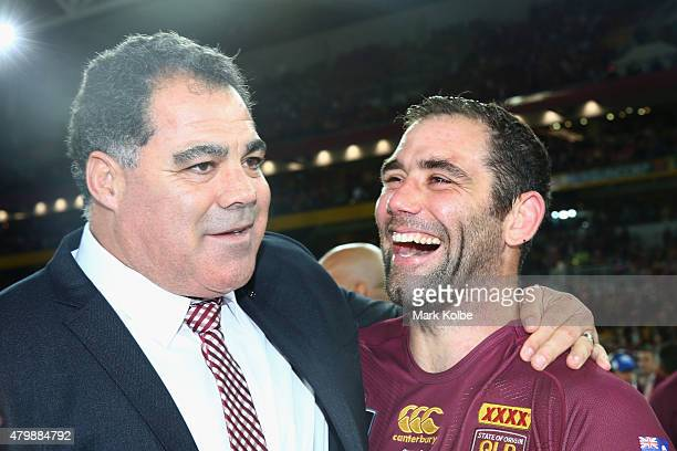 Maroons coach Mal Meninga and Maroons captain Cameron Smith of the Maroons celebrate victory during game three of the State of Origin series between...