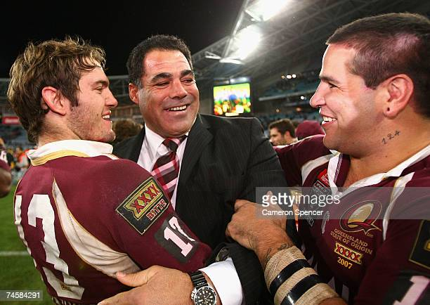 Maroons coach Mal Meninga celebrates with Dallas Johnson and Carl Webb of the Maroons after winning game two of the ARL State of Origin series...