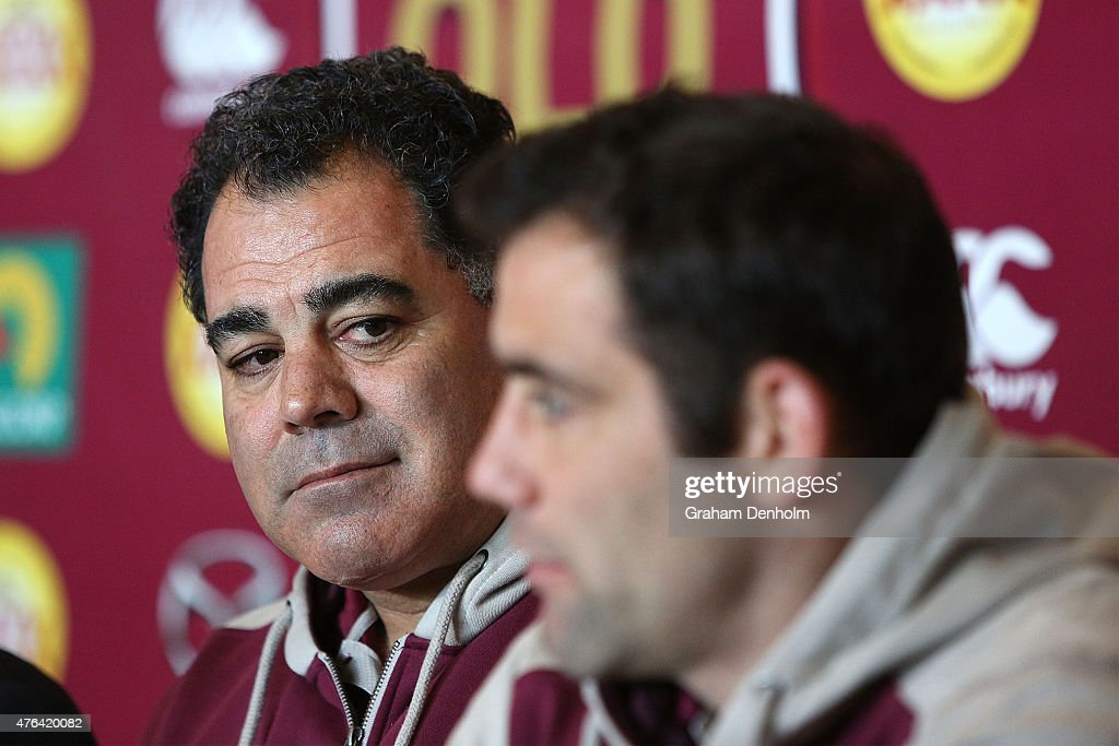 Maroons Coach Mal Meninga (L) looks on as Cameron Smith talks to the media during the Queensland Maroons State of Origin team announcement at Melbourne Cricket Ground on June 9, 2015 in Melbourne, Australia.