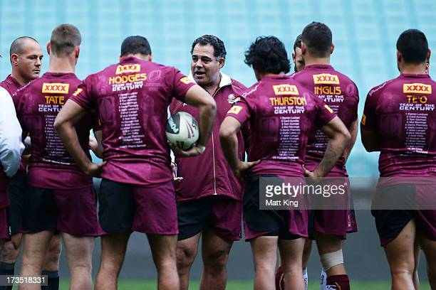 Maroons coach Mal Meninga speaks to Maroons players during a Queensland Maroons State of Origin training session at ANZ Stadium on July 16 2013 in...