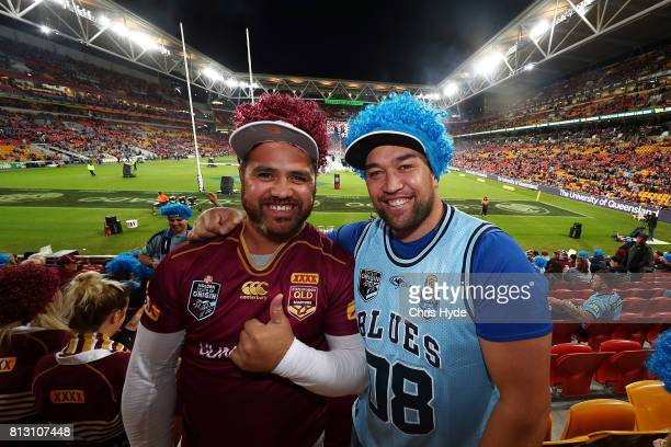 Maroons fan and Blues fan pose before game three of the State Of Origin series between the Queensland Maroons and the New South Wales Blues at...