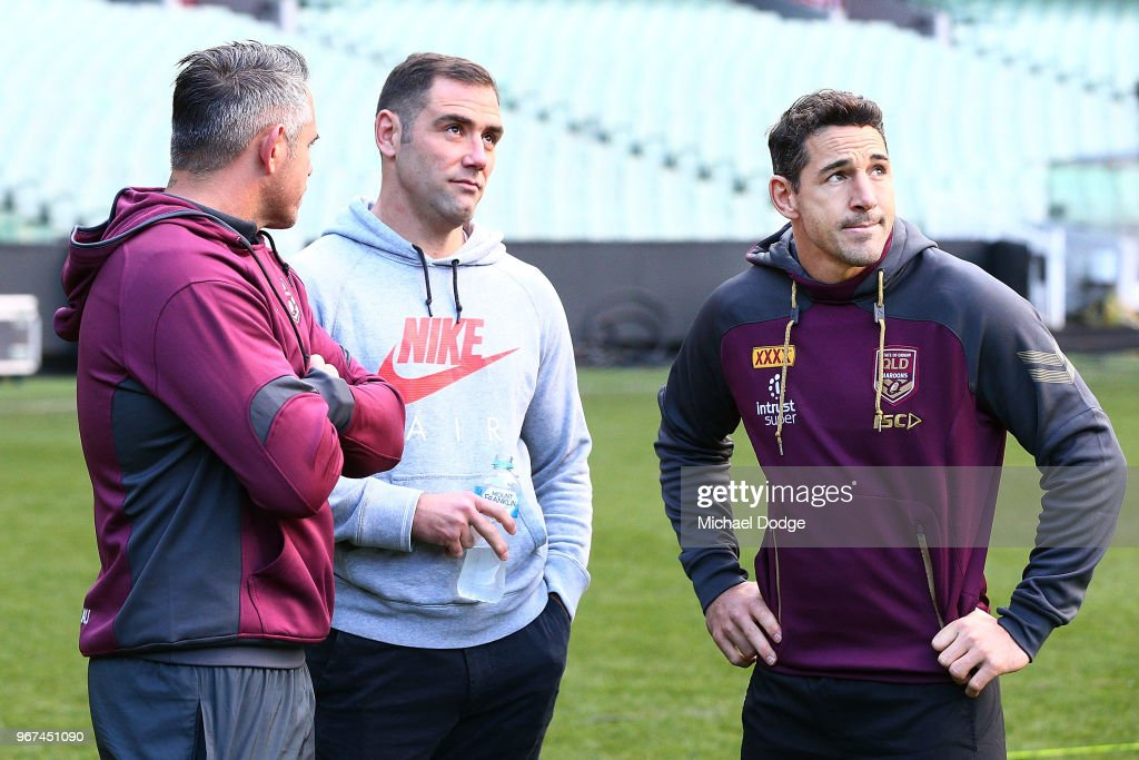 Maroons legend Cameron Smith (C) and Billy Slater, out with a hamstring injury, look on during a Queensland Maroons Captain's Run at the Melbourne Cricket Ground on June 5, 2018 in Melbourne, Australia.