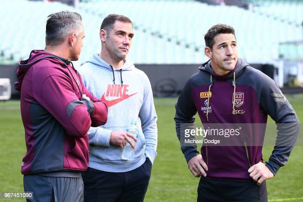 Maroons legend Cameron Smith and Billy Slater out with a hamstring injury look on during a Queensland Maroons Captain's Run at the Melbourne Cricket...