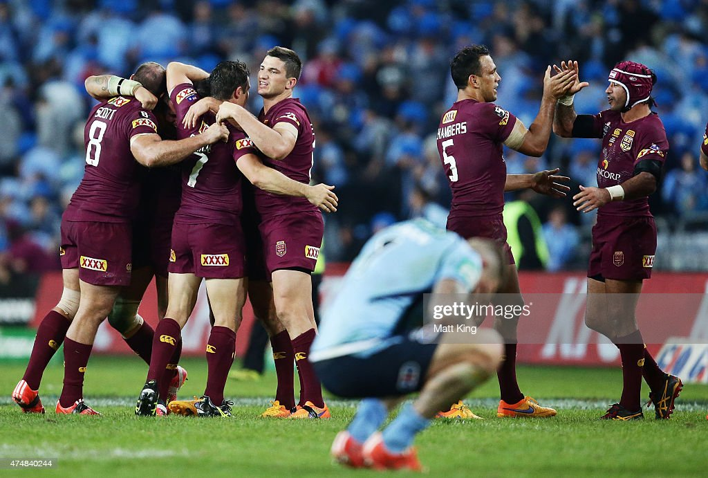 Maroons players celebrate victory at fulltime during game one of the State of Origin series between the New South Wales Blues and the Queensland Maroons at ANZ Stadium on May 27, 2015 in Sydney, Australia.