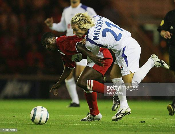 Maroslav Matusovic of Banik Ostrava tackles George Boateng of Middlesbrough during the UEFA Cup first round, first leg match between Middlesbrough...