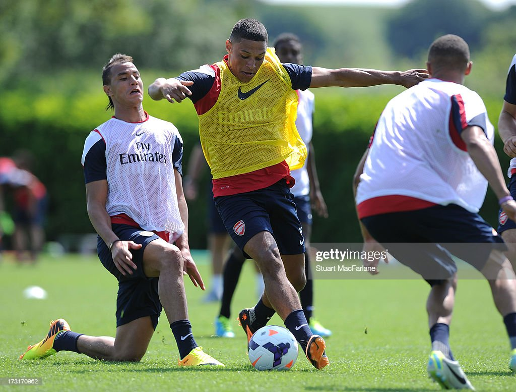 Marouane Chamakh and Alex Oxlade-Chamberlain of Arsenal during a training session at London Colney on July 09, 2013 in St Albans, England.