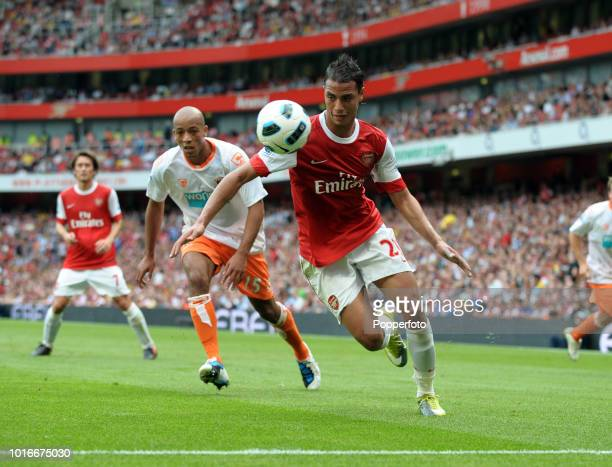 Marouane Chamakh of Arsenal and Alex Baptiste of Blackpool in action during the Barclays Premier League match between Arsenal and Blackpool at The...