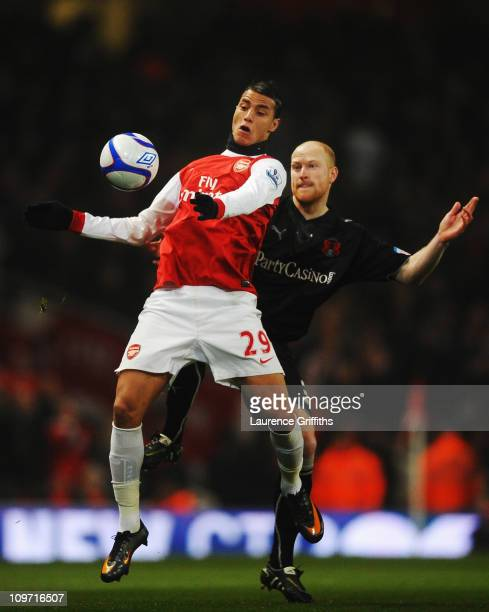 Marouane Chamakh of Arsenal holds off the challenge of Andrew Whing of Leyton Orient during the FA Cup sponsored by EON 5th Round Replay match...