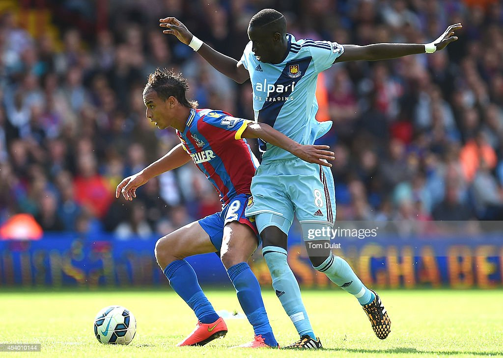 Marouane Chamakh (L) of Crystal Palace and Cheikhou Kouyate of West Ham in action during the Premiere League match between Crystal Palace and West Ham United at Selhurst Park on August 23, 2014 in London, England.