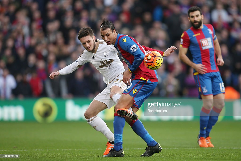 Marouane Chamakh of Crystal Palace and Matt Grimes of Swansea City compete for the ball during the Barclays Premier League match between Crystal Palace and Swansea City at Selhurst Park on December 28, 2015 in London, England.