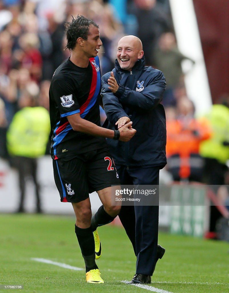 Marouane Chamakh of Crystal Palace celebrates with his manager Ian Holloway after scoring their first goal during the Barclays Premier League match between Stoke City and Crystal Palace at Britannia Stadium on August 24, 2013 in Stoke on Trent, England.