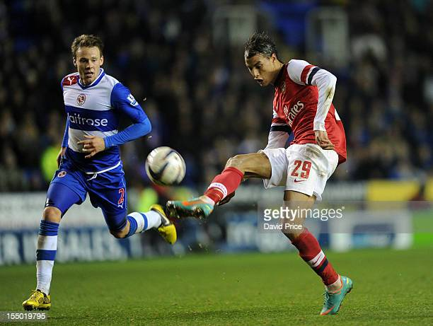 Marouane Chamakh scores Arsenal's seventh goal as Chris Gunter of Reading closes in during the Capital One Cup match between Arsenal and Reading at...
