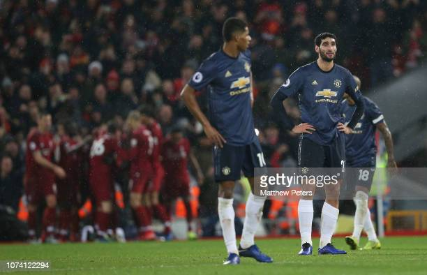 Marouane Fellaini and Marcus Rashford of Manchester United react to conceding a goal to Xherdan Shaqiri of Liverpool during the Premier League match...
