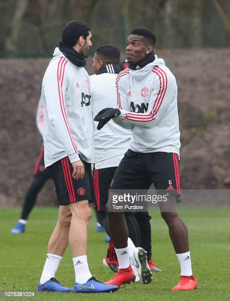 Marouane Fellaini and Paul Pogba of Manchester United in action during a first team training session at Aon Training Complex on December 28 2018 in...