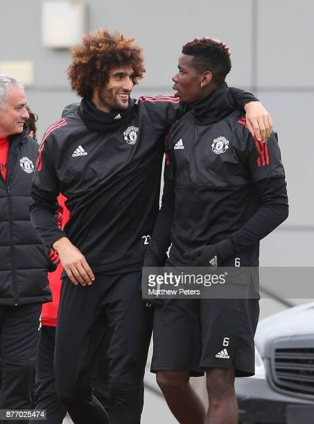 Marouane Fellaini and Paul Pogba of Manchester United in action during a first team training session at Aon Training Complex on November 21 2017 in...