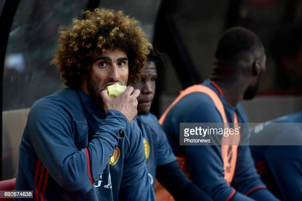 Marouane Fellaini midfielder of Belgium pictured while eating an apple on the bench during a FIFA international friendly match between Belgium and...
