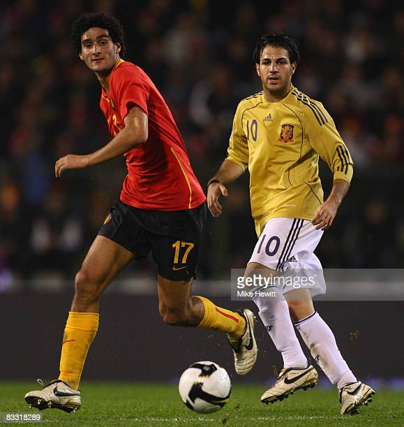 Marouane Fellaini of Belgium and Cesc Fabregas of Spain watch the ball during the FIFA 2010 World Cup Group 5 Qualifier between Belgium and Spain at...