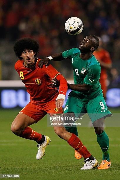 Marouane Fellaini of Belgium and Ismael Cheick Tiote of Ivory Coast battle for the ball during the International Friendly match between Belgium and...