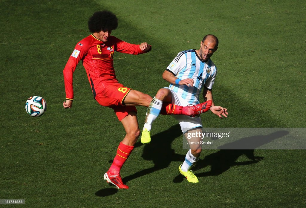Marouane Fellaini of Belgium and Pablo Zabaleta of Argentina compete for the ball during the 2014 FIFA World Cup Brazil Quarter Final match between Argentina and Belgium at Estadio Nacional on July 5, 2014 in Brasilia, Brazil.