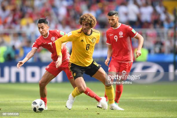 Marouane Fellaini of Belgium battles for possession with Saifeddine Khaoui of Tunisia during the 2018 FIFA World Cup Russia group G match between...