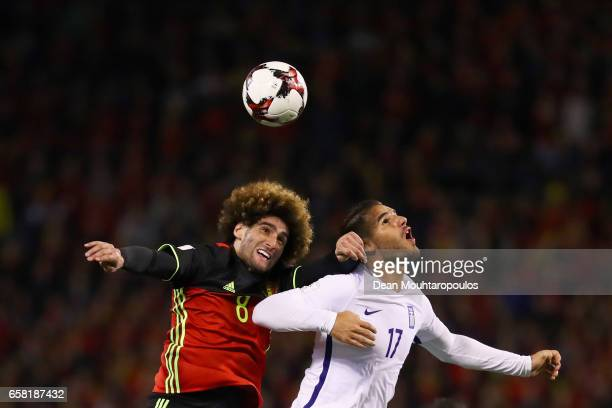 Marouane Fellaini of Belgium battles for the ball with Panagiotis Tachtsidis of Greece during the FIFA 2018 World Cup Group H Qualifier match between...