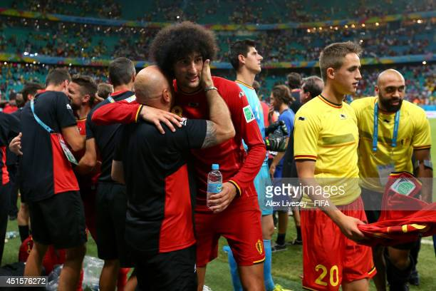 Marouane Fellaini of Belgium celebrates the 21 win with his team staffs after the 2014 FIFA World Cup Brazil Round of 16 match between Belgium and...
