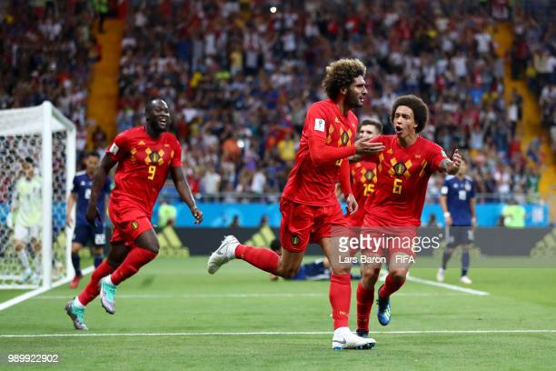 Marouane Fellaini of Belgium celebrates with team mates Axel Witsel and Romelu Lukaku after scoring his team's second goal during the 2018 FIFA World...