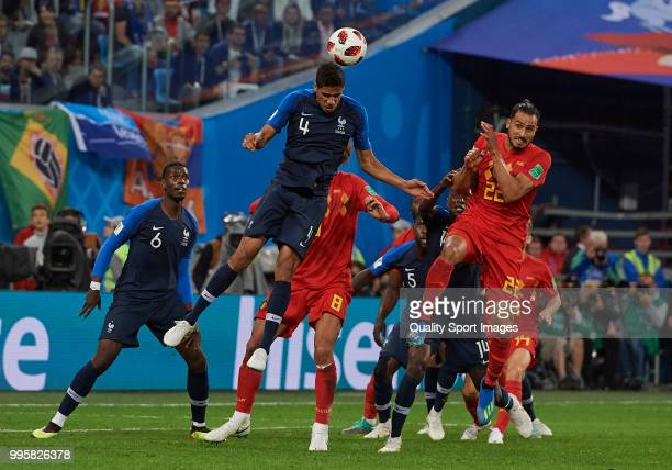 Marouane Fellaini of Belgium competes for the ball with Raphael Varane of France during the 2018 FIFA World Cup Russia Semi Final match between...