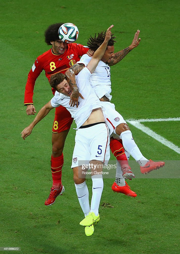 Marouane Fellaini of Belgium goes up for a header against Matt Besler (C) and Jermaine Jones of the United States during the 2014 FIFA World Cup Brazil Round of 16 match between Belgium and the United States at Arena Fonte Nova on July 1, 2014 in Salvador, Brazil.