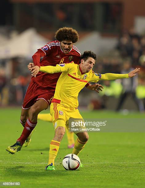 Marouane Fellaini of Belgium in action with Joe Allen of Wales during the Group B UEFA European Championship 2016 Qualifier match between Belgium and...
