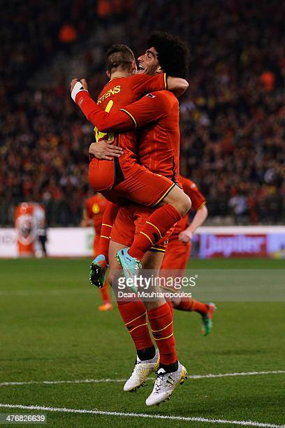 Marouane Fellaini of Belgium is congratulated by team mate Dries Mertens after he scores the first goal of the game during the International Friendly...
