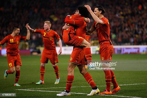 Marouane Fellaini of Belgium is congratulated by tema mates after he scores the first goal of the game during the International Friendly match...