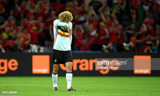 Marouane Fellaini of Belgium reacts after Wales' second goal during the UEFA EURO 2016 quarter final match between Wales and Belgium at Stade...