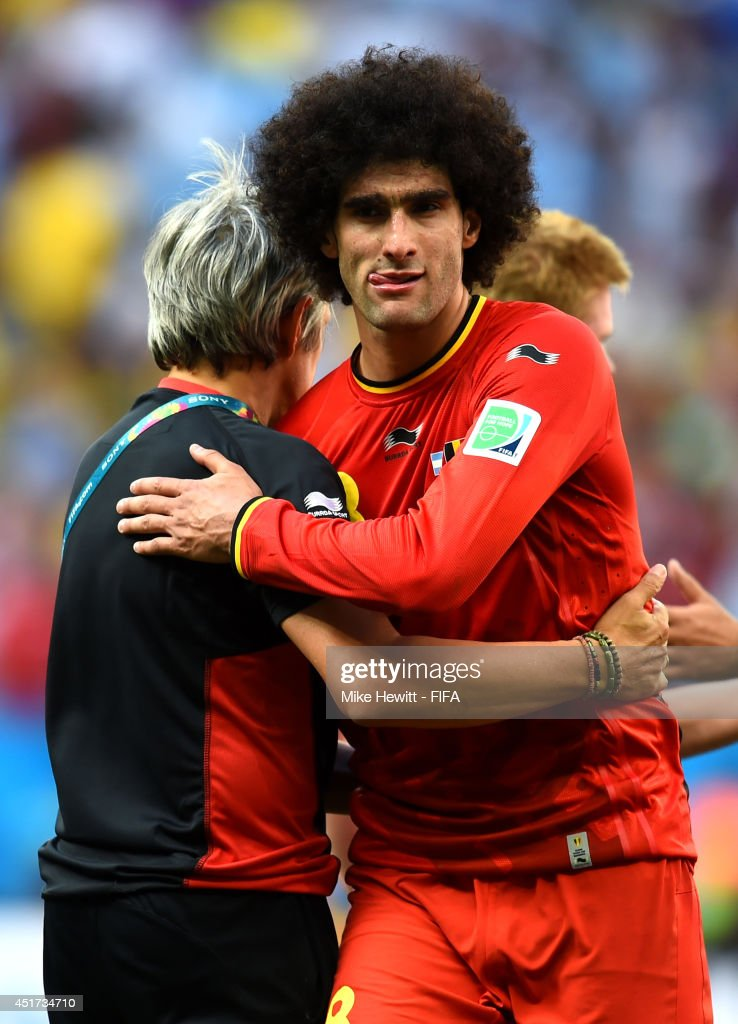 Marouane Fellaini of Belgium shows his dejection while walking off the pitch after the 0-1 defeat in the 2014 FIFA World Cup Brazil Quarter Final match between Argentina and Belgium at Estadio Nacional on July 5, 2014 in Brasilia, Brazil.