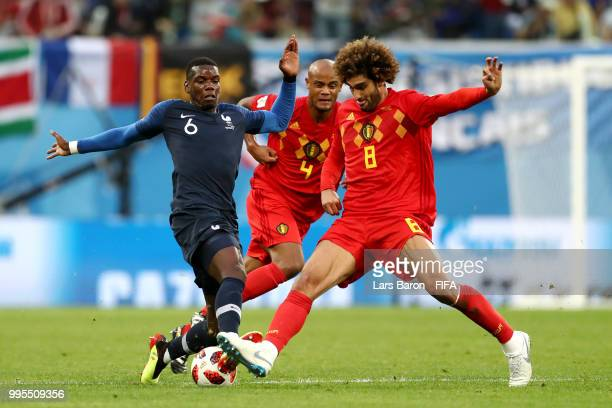 Marouane Fellaini of Belgium tackles Paul Pogba of France during the 2018 FIFA World Cup Russia Semi Final match between Belgium and France at Saint...