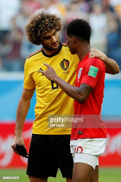 Marouane Fellaini of Belgium talks to Marcus Rashford of England after the 2018 FIFA World Cup Russia 3rd Place Playoff match between Belgium and...
