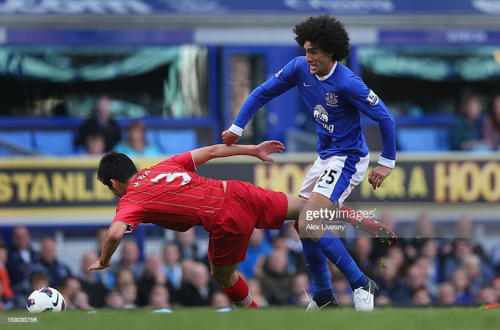 Marouane Fellaini of Everton battles for the ball with Maya Yoshida of Southampton during the Barclays Premier League match between Everton and Southampton at Goodison Park on September 29, 2012 in Liverpool, England.