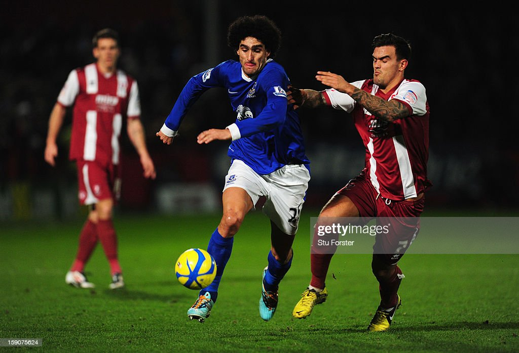 Marouane Fellaini of Everton battles with Marlon Pack of Cheltenham Town during the FA Cup with Budweiser Third Round match between Cheltenham Town and Everton at Abbey Business Stadium on January 7, 2013 in Cheltenham, England.