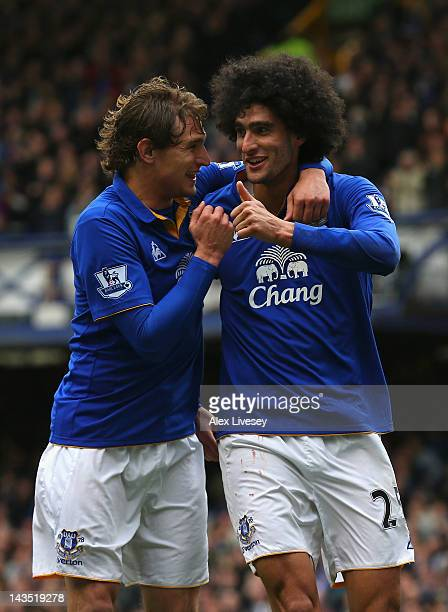 Marouane Fellaini of Everton celebrates scoring his goal with Nikica Jelavic during the Barclays Premier League match between Everton and Fulham at...