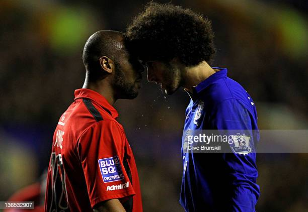Marouane Fellaini of Everton clashes with Keiron St Aimie of Tamworth following an altercation in the box during the FA Cup Third Round match between...
