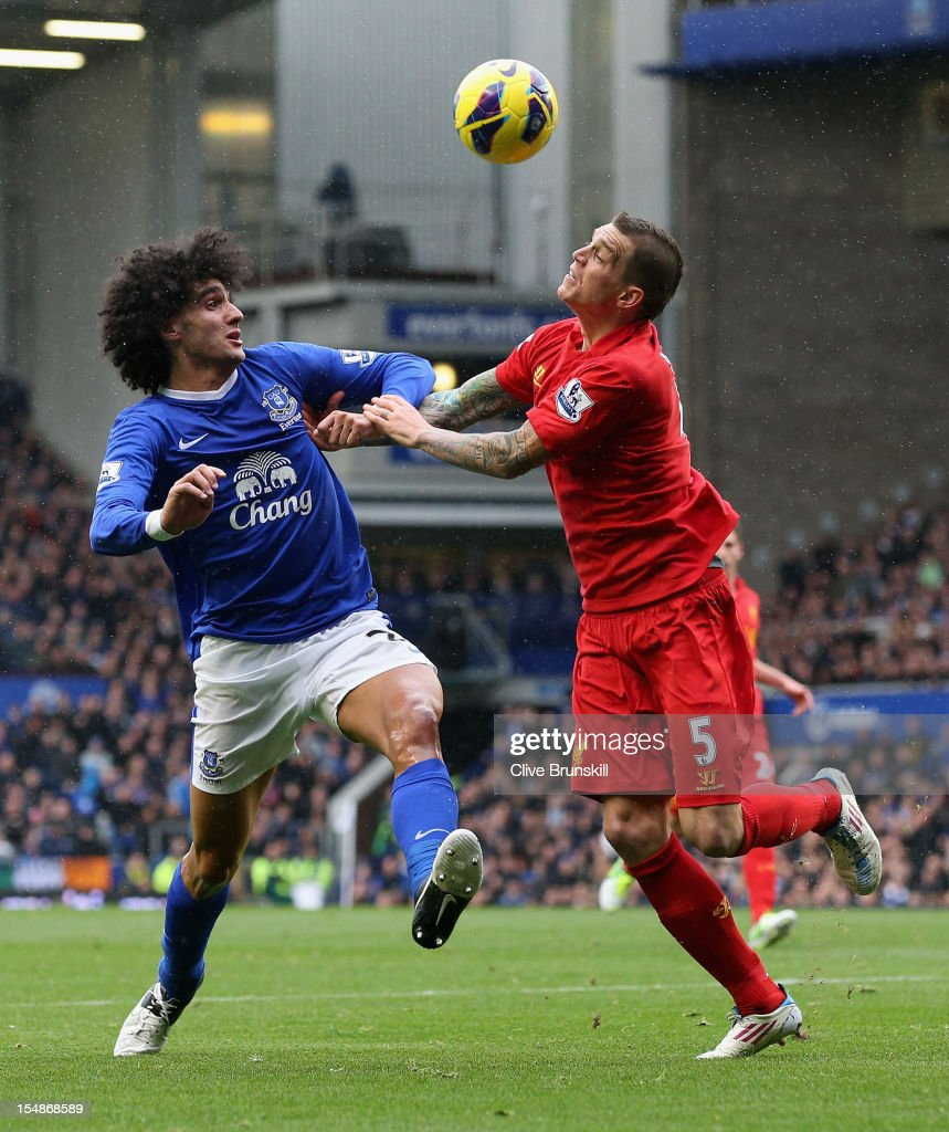 Marouane Fellaini of Everton competes with Daniel Agger of Liverpool during the Barclays Premier League match between Everton and Liverpool at Goodison Park on October 28, 2012 in Liverpool, England.