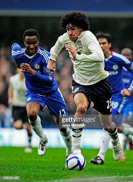 Marouane Fellaini of Everton is pursued by John Obi Mikel of Chelsea during the FA Cup sponsored by EON 4th round replay match between Chelsea and...