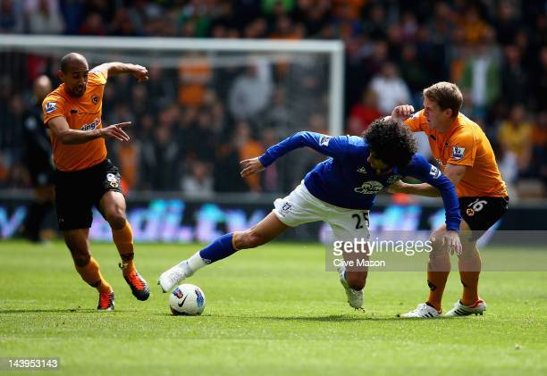 Marouane Fellaini of Everton is tackled by Christophe Berra of Wolves during the Barclays Premier League match between Wolverhampton Wanderers and...