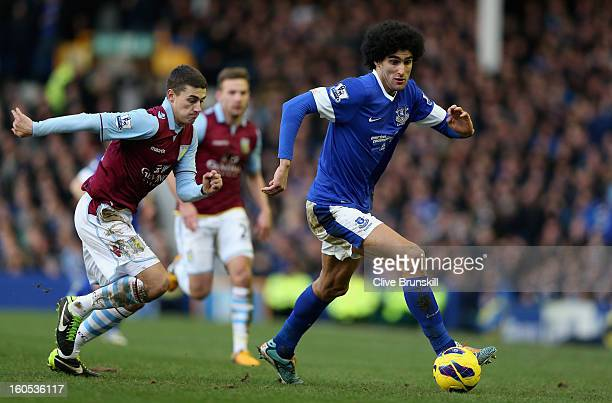 Marouane Fellaini of Everton moves away from Matthew Lowton of Aston Villa during the Barclays Premier League match between Everton and Aston Villa...