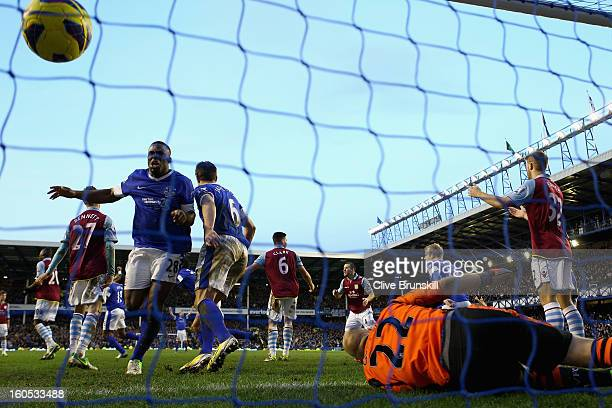 Marouane Fellaini of Everton scores his teams third and equalizing goal past Aston Villa keeper Brad Guzan during the Barclays Premier League match...