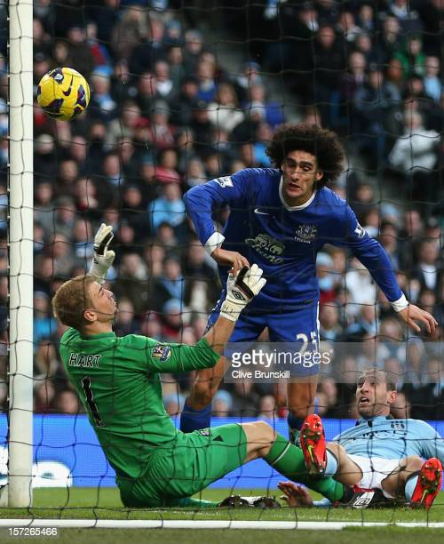 Marouane Fellaini of Everton scores the opening goal past Joe Hart of Manchester City during the Barclays Premier League match between Manchester...
