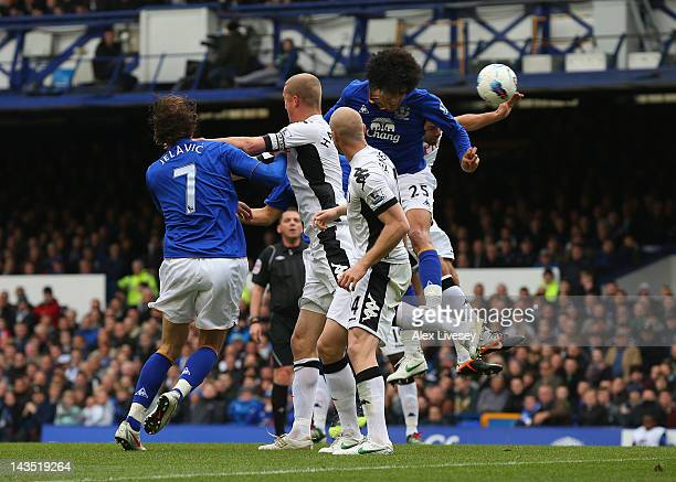 Marouane Fellaini of Everton scores the second goal during the Barclays Premier League match between Everton and Fulham at Goodison Park on April 28,...