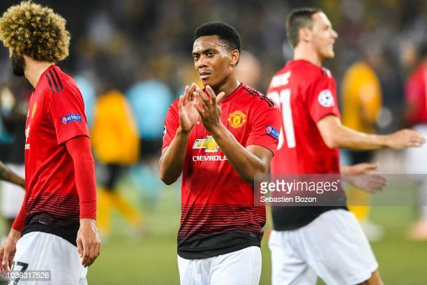 Marouane Fellaini of Manchester Anthony Martial of Manchester and Nemanja Matic of Manchester celebrates during the Champions League match between...