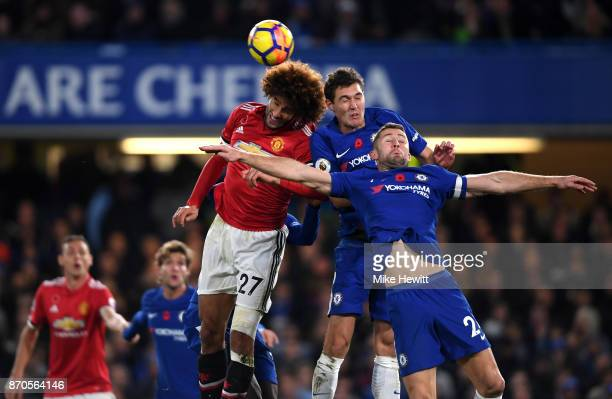 Marouane Fellaini of Manchester United and Andreas Christensen of Chelsea battle for possession in the air during the Premier League match between...